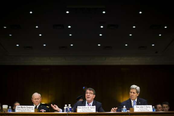 From left, Joint Chief Chairman Gen. Martin Dempsey, Defense Secretary Ash Carter, and Secretary of State John Kerry, testify on Capitol Hill in Washington, Wednesday, March 11, 2015, before the Senate Foreign Relation Committee. Three of America's top national security officials faced questions on Capitol Hill about new war powers being drafted to fight Islamic State militants, Iran's sphere of influence and hotspots across the Mideast. (AP Photo/Pablo Martinez Monsivais)