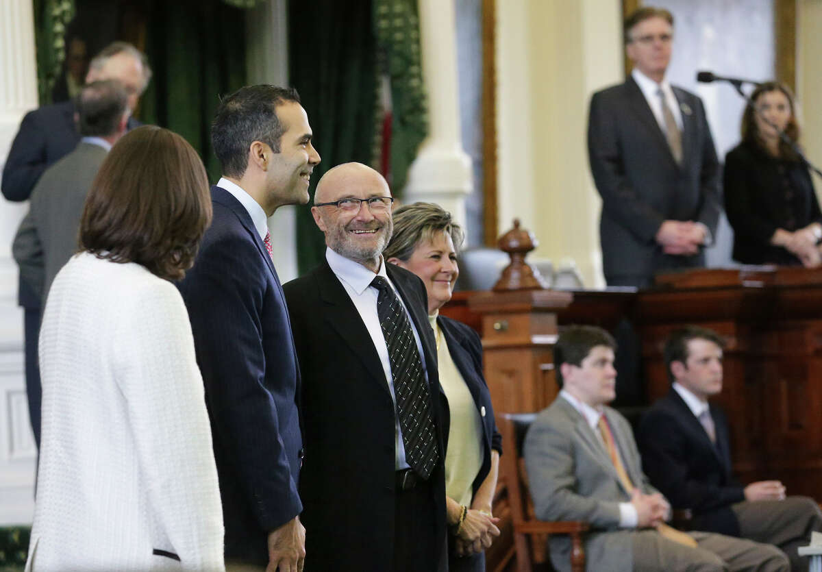 Phil Collins listens to Land Commissioner George P. Bush as he is recognized in the Senate as an honorary Texan as he visits both houses of the Legislature on March 11, 2015.