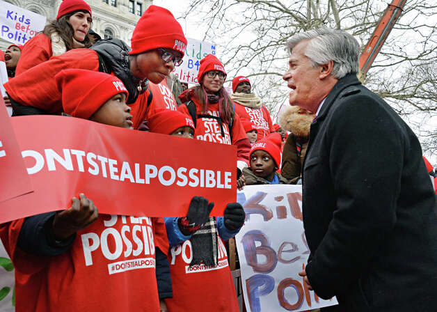 Senate Majority Leader Dean Skelos, right, speaks with school children during a pro-charter rally at the Capitol Wednesday, March 4, 2015, in Albany, N.Y.  (John Carl D'Annibale / Times Union) Photo: John Carl D'Annibale, Albany Times Union / 00030815A
