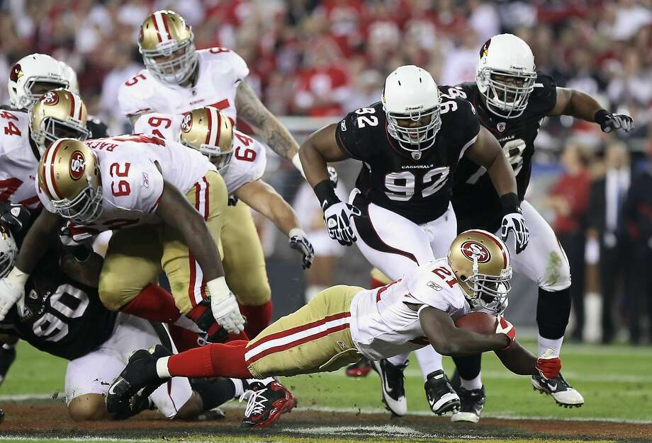 Dan Williams (92) will play for the Raiders next season. He started nine games for the Cardinals in 2014. Photo: Christian Petersen, Getty Images