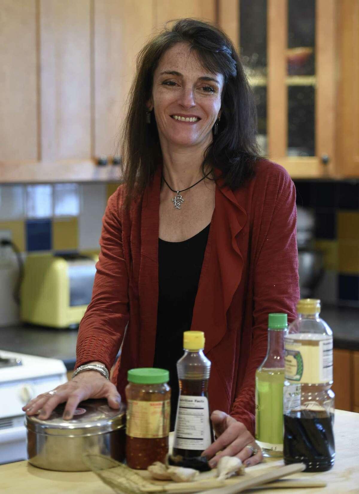 Caroline Barrett works in her kitchen Monday, Feb. 2, 2015, in Delmar, N.Y. (Skip Dickstein/Times Union) ORG XMIT: MER2015020214591994