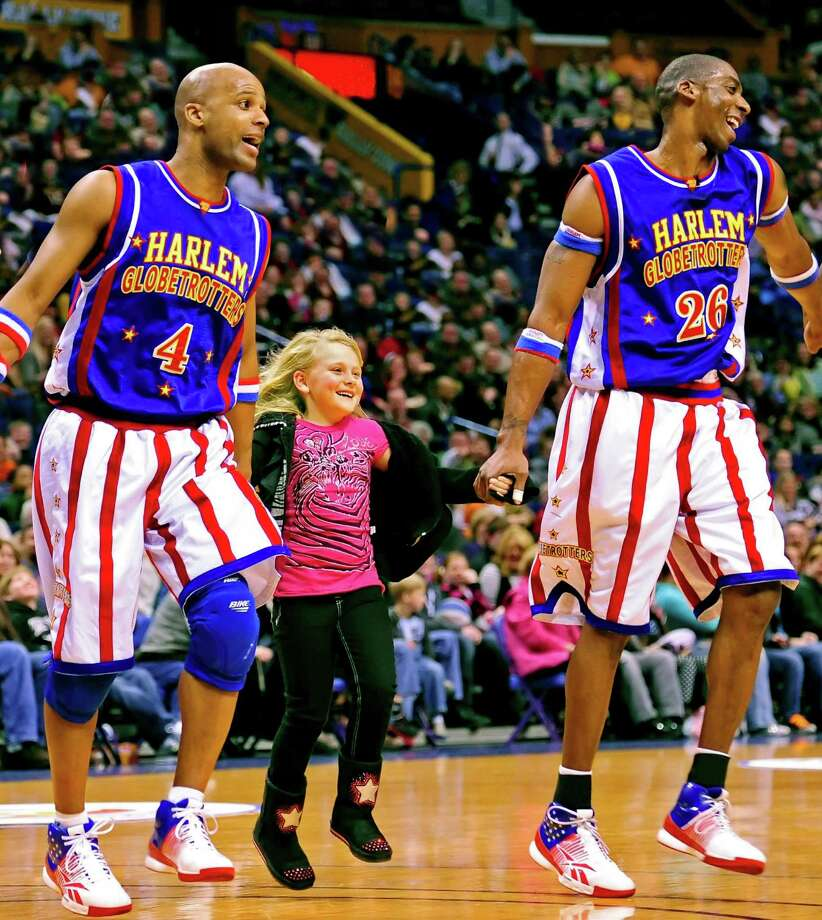The Harlem Globetrotters, known for their high jinks and good humor, will be in Bridgeport on Thursday, March 19, to play a game against the Washington Generals. Photo: Contributed Photo / Connecticut Post Contributed