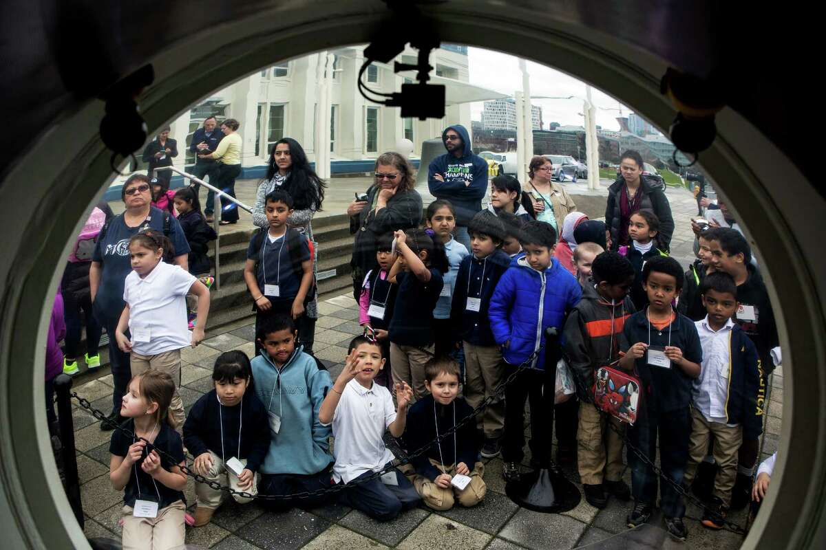 Children gather around to check out OceanGate's next generation submersible, the Cyclops 1, on Wednesday, March 11, 2015, at MOHAI in Seattle, Washington. The Cyclops series represents a Seattle-made innovation with a design that takes advantage of new materials, existing commercial off-the-shelf technologies and efficient operations to support the world's growing need for on-site, real-time collaboration at depth.