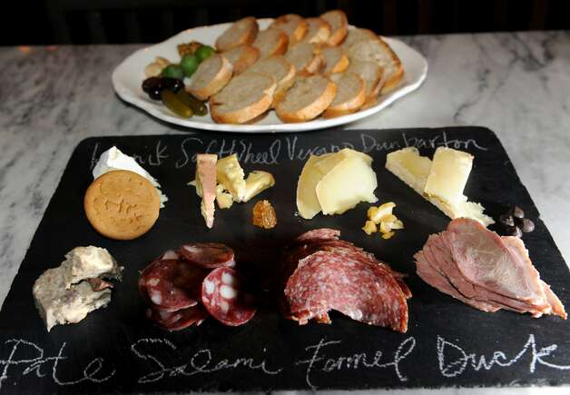 "Lucas Confectionery, 12 Second St., Troy. www.lucasconfectionery.com. Wine bar.  ""The wine list is carefully curated and fairly priced, including several offerings at tap for about $6 per glass, and the menu is designed for grazing: Cheese, charcuterie, hummus, tapenade, cold noddles, perhaps a soft-boiled egg with mushrooms."" (Cindy Schultz / Times Union) Photo: Cindy Schultz"