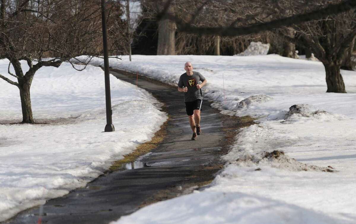 Jason Beckett, of Darien, goes for a run wearing shorts and a T-shirt through Binney Park in Greenwich, Conn. Wednesday, March 11, 2015. Wednesday's weather was a relative heat wave with temperatures rising into the mid-50s. Temperatures for the rest of the week andd into the weekend are expected to be in the mid-40s.