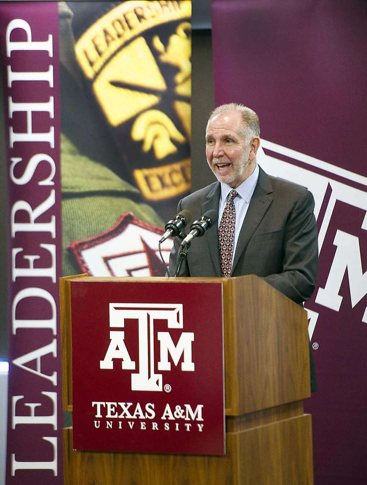 File - In this Feb. 9, 2015 file photo, newly-named president of Texas A&M University Michael Young answers questions during a news conference held in Rudder Tower on the A&M campus in College Station, Texas. Young, is in line to receive $1 million annually and a signing bonus up to $800,000, the Eagle newspaper reported Tuesday, March 10, 2015, on the proposed contract. (AP Photo/College Station Eagle, Dave McDermand, File)