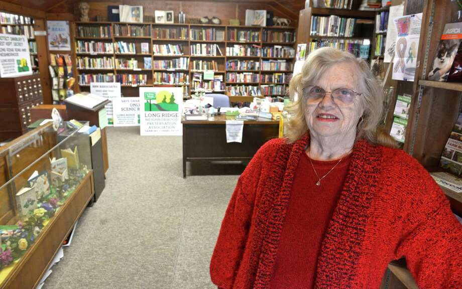 Barbara Fulton, a librarian at the Long Ridge Library in Danbury, is part of a neighborhood association that opposes the plan by Writer's Institute of selling an 18-acre property to an unaffiliated church group. They believe that the church would represent much more traffic and disruption than the current use. Wednesday, March 11, 2015, in Danbury, Conn. Photo: H John Voorhees III / The News-Times