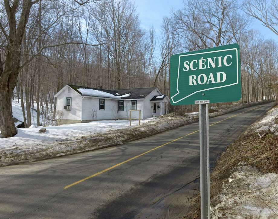 A neighborhood association opposes the plan by Writer's Institute of selling an 18-acre property to an unaffiliated church group. They believe that the church would represent much more traffic and disruption than the current use. Wednesday, March 11, 2015, in Danbury, Conn. A scenic road sign identifies Long Ridge Road as the only scenic road in Danbury. Photo: H John Voorhees III / The News-Times