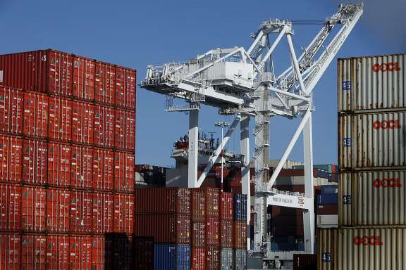 Containers from cargo ships are seen piled on top of each other in the Port of Oakland in Oakland, Calif. Saturday, February 21, 2015. The Port of Oakland recently reached a deal with longshoremen after labor disputes have created a backup of ships with cargo at the port.