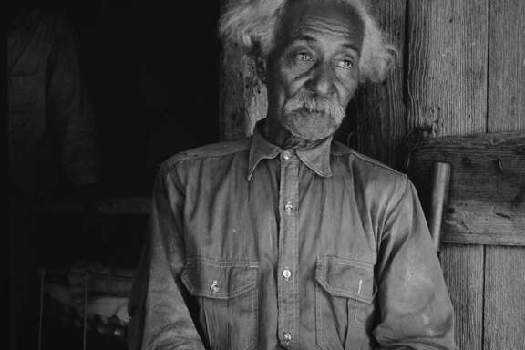 Bob Lemmons, a former slave born in San Antonio, is pictured in August 1936 in Carrizo Springs.