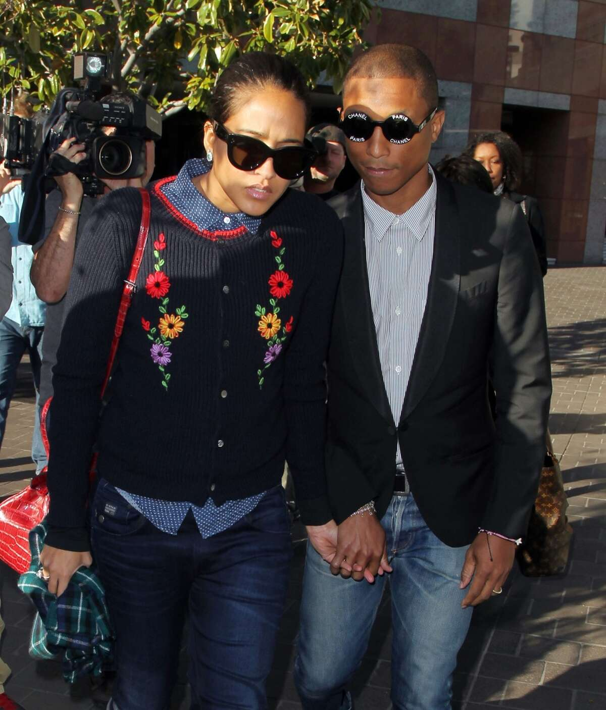 """Musician Pharrell Williams and his wife Helen Lasichanh are seen outside the Roybal Federal Building on March 5, 2015 in Los Angeles, California. Williams and co-writers of the song """"Blurred Lines"""" are being sued by the children of singer Marvin Gaye for using elements of Gaye's song """"Got to Give it Up"""" in """"Blurred Lines."""""""
