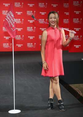 SINGAPORE - MARCH 03:  Lydia Ko of New Zealand poses on the catwalk at the launch event for the HSBC Women's Champions at the Fairmont Hotel on March 3, 2015 in Singapore, Singapore.  (Photo by Andrew Redington/Getty Images)