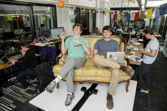 Brooks Buffington, left, and Tyler Droll, who created the social media app Yik Yak in 2013 while students at Furman University, at offices in Atlanta, Feb 26, 2015. A number of universities have been roiled by offensive anonymous posts on this social media app, which does not sort messages according to friends or followers but by geographic location or, in many cases, by university. (Raymond McCrea Jones/The New York Times)