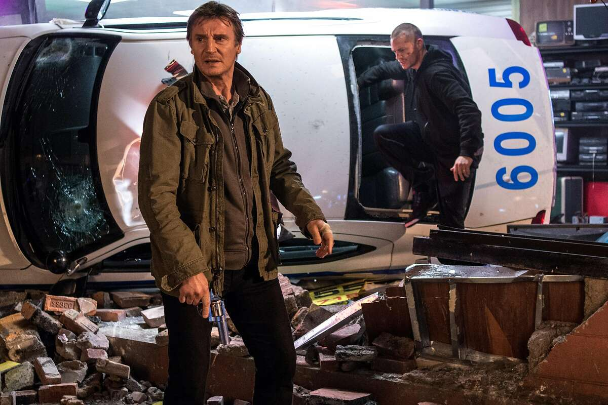 """In this image released by Warner Bros. Pictures, Joel Kinnaman and Liam Neeson, left, appear in a scene from """"Run All Night."""" (AP Photo/Warner Bros. Pictures, Myles Aronowitz)"""