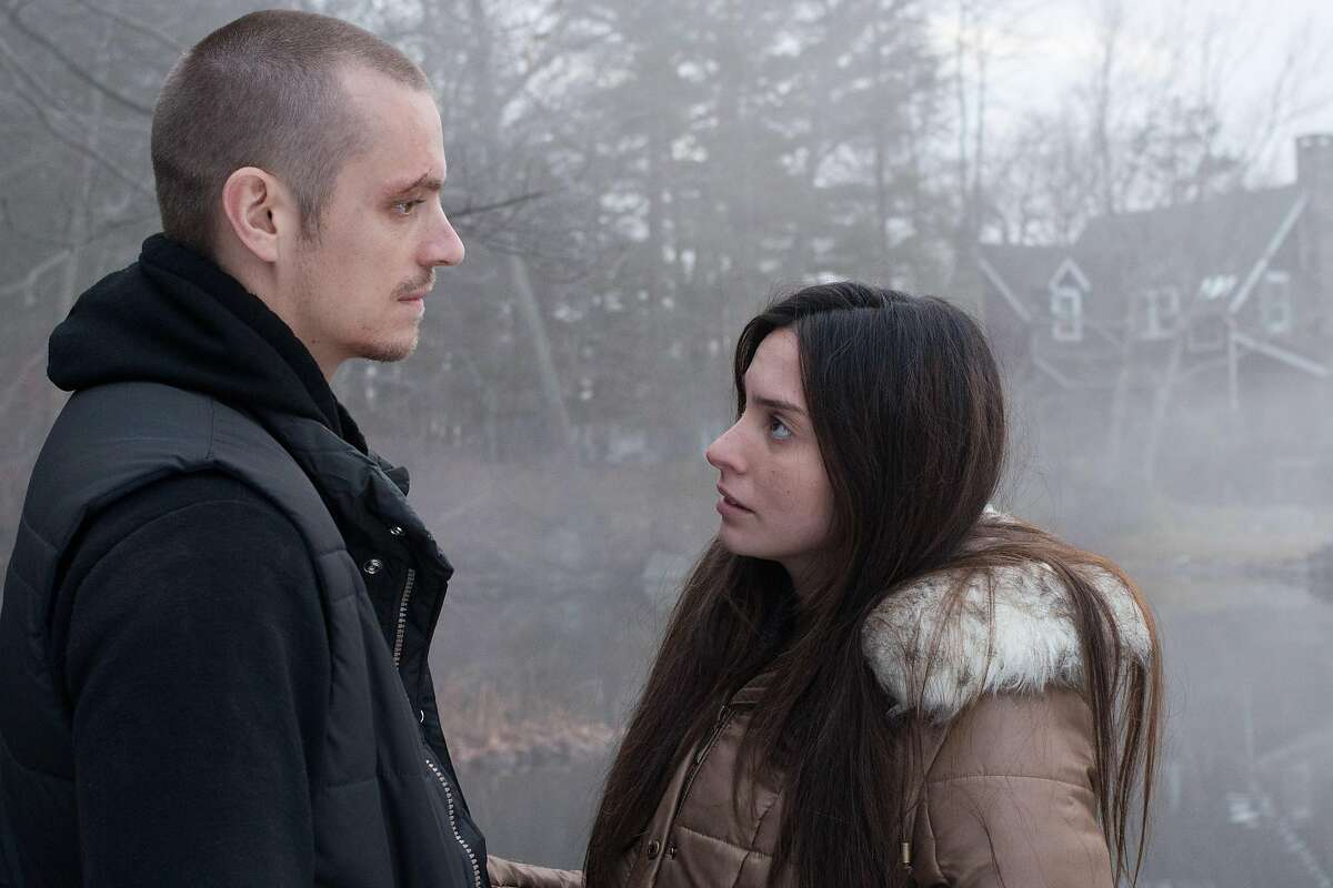 """In this image released by Warner Bros. Pictures, Joel Kinnaman, left, and Genesis Rodriguez appear in a scene from """"Run All Night."""" (AP Photo/Warner Bros. Pictures, Myles Aronowitz)"""
