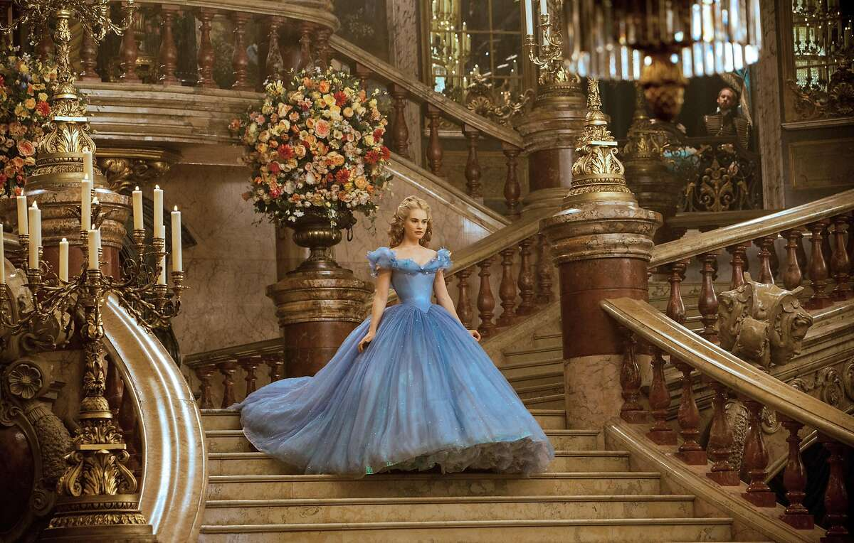 """This image released by Disney shows Lily James as Cinderella in Disney's live-action feature inspired by the classic fairy tale, """"Cinderella."""" (AP Photo/Disney, Jonathan Olley)"""