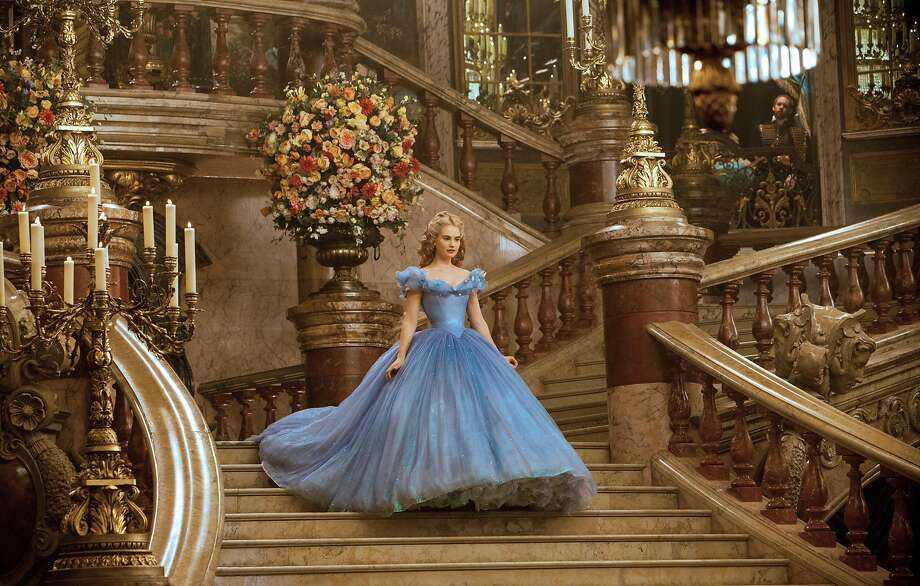 """Lily James, above and at left below with Cate Blanchett as her evil stepmother, stars as """"Cinderella."""" Photo: Jonathan Olley, Associated Press"""