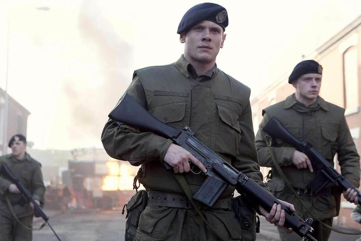 """Jack O'Connell (center) plays a British soldier abandoned by his unit in Northern Ireland during the Troubles in """"'71."""" Illustrates FILM-71-ADV13 (category e), by Stephanie Merry © 2015, The Washington Post. Moved Wednesday, March 11, 2015. (MUST CREDIT: Dean Rogers/Roadside Attractions.)"""