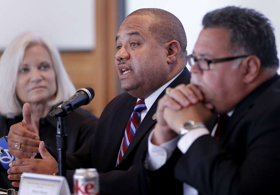 """Ron Davis, former East Palo Alto police chief (center), says recent officer involved killings have placed law enforcement at a """"defining moment."""" Photo: Brant Ward, The Chronicle"""
