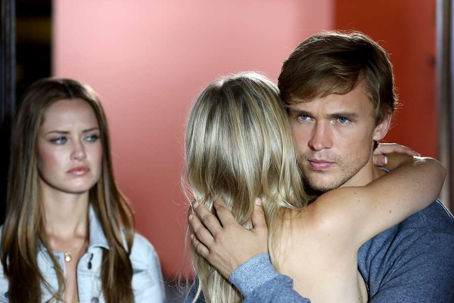 """Merritt Patterson (left) plays Ophelia, the U.S.-raised daughter of the royal family's head of security, with Sophie Colquhoun as Gemma and William Moseley as the heir apparent, Prince Liam, in """"The Royals."""" Photo: E! Entertainment"""