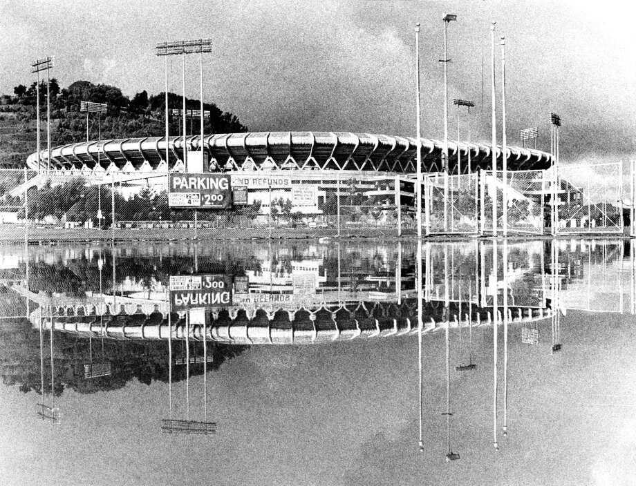 Candlestick Park is reflected in Lake Candlestick — its flooded parking lot — in a rare scene captured in December 1981. Photo: Fred Larson / The Chronicle / ONLINE_YES