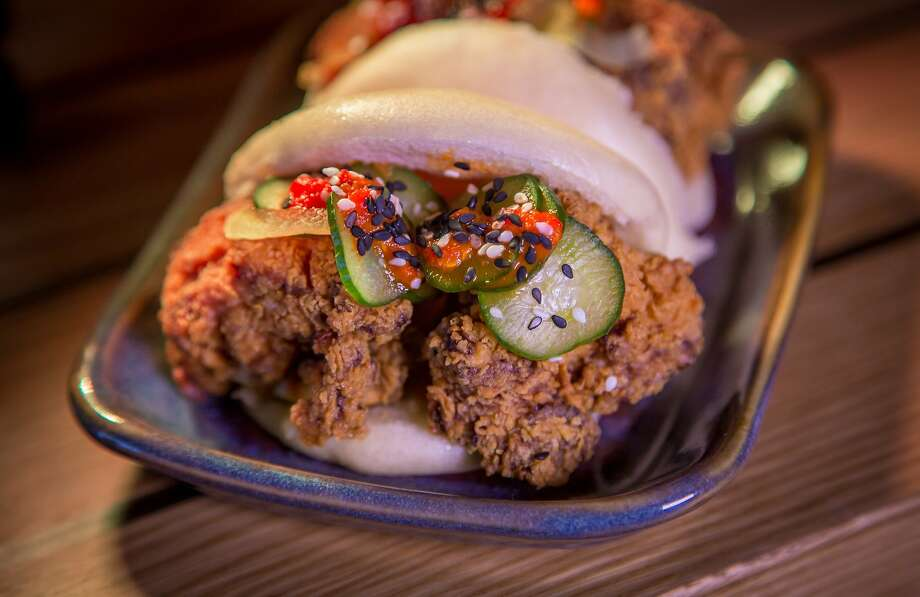 A contender for the best fried chicken at Hapa Ramen: Buttermilk-marinated nuggets piled into a steamed bun ($5) with bread-and-butter pickles and hot sauce. Photo: John Storey, Special To The Chronicle