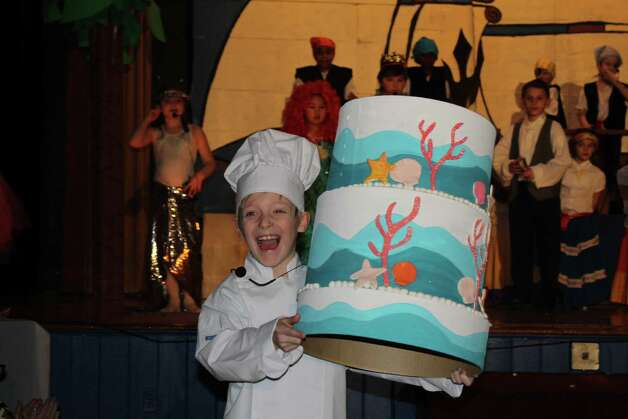 "The St. Augustine School Drama Club, including over 50 student performers, presented ""The Little Mermaid"" in St. Augustine's Hall in Troy on March 5 and 6. Here, Phillipe (second-grader Keegan Giles) presents the wedding cake at the conclusion of the performance."