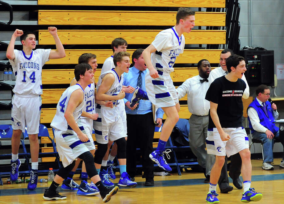 Fairfield Ludlowe team members leap of the bench after defeating Hamden, during Class LL Second Round of boys basketball action in Fairfield, Conn. on Wednesday Mar. 11, 2015. Photo: Christian Abraham / Connecticut Post