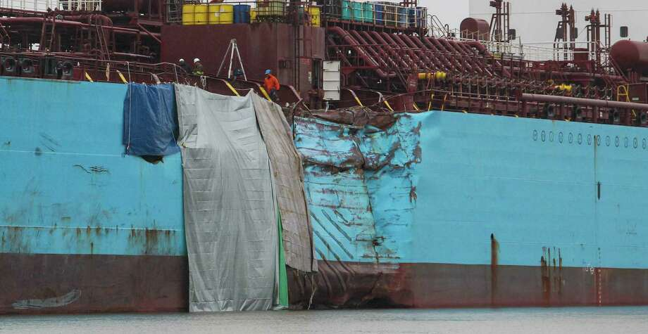 The hull of the chemical tanker Carla Maersk shows the results of its collision Monday with the Conti Peridot, a Liberian bulk carrier, in the Houston Ship Channel. Photo: Billy Smith II, Staff / © 2015 Houston Chronicle