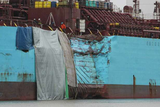 The hull of the chemical tanker Carla Maersk shows the results of its collision Monday with the Conti Peridot, a Liberian bulk carrier, in the Houston Ship Channel.