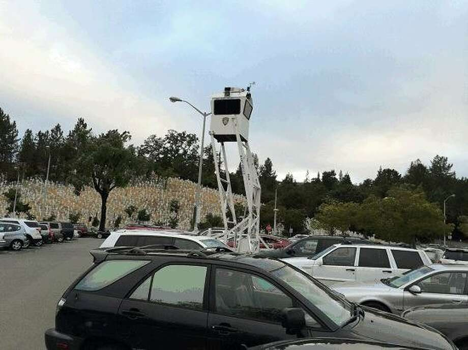 BART's Skywatch mobile observation tower looms over the parking lot at a station in Lafayette. The tower's appearance in Berkeley this week raised questions among confused commuters. Photo: Courtesy, BART
