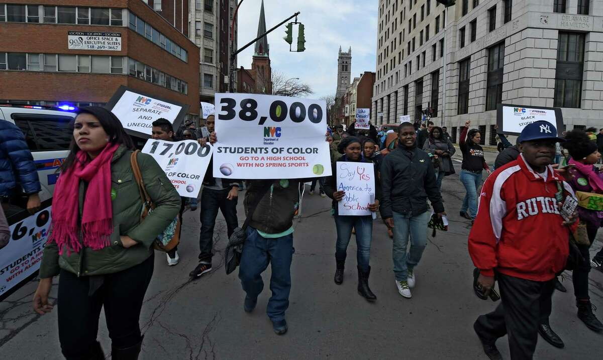 A large group of people march in the Parade for Public Education Wednesday afternoon, March 11, 2015, in Albany, N.Y. The demonstrators were showing their solidarity against Governor Cuomo's budget figures for public School. (Skip Dickstein/Times Union)