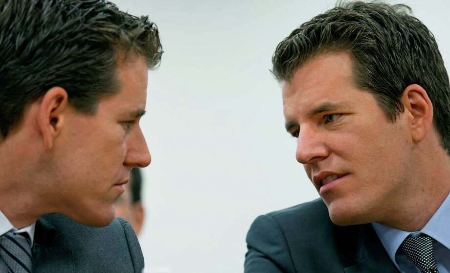 Twins Cameron, left, and Tyler Winklevoss. Photo: Craig Ruttle, FRE / FR61802 AP