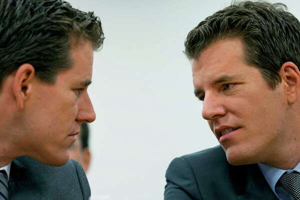 Twins Cameron, left, and Tyler Winklevoss will tell the Southwest Interactive Festival what bitcoin needs to do to succeed as a mainstream currency.