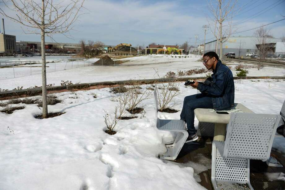 Junior Souvenance, of Bridgeport, finds a quiet spot to practice his music Wednesday, Mar. 11, 2015 in Knowlton Park facing the Pequonnock River. Photo: Autumn Driscoll / Connecticut Post