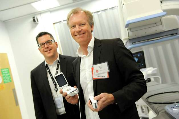 Principal scientist Jim Miller, left, joins Anders Wold, president and CEO of GE ultrasound, who holds an ultrasound device, in the interventional and ultrasound lab on Wednesday, March 11, 2015, at GE Global Research on Niskayuna, N.Y. (Cindy Schultz / Times Union) Photo: Cindy Schultz / 00030972A