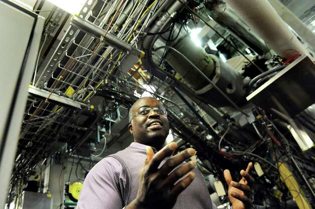Wole Akinyemi, lab manager of internal combustion, talks about the single cylinder engine lab on Wednesday, March 11, 2015, at GE Global Research on Niskayuna, N.Y. (Cindy Schultz / Times Union) Photo: Cindy Schultz / 00030972A
