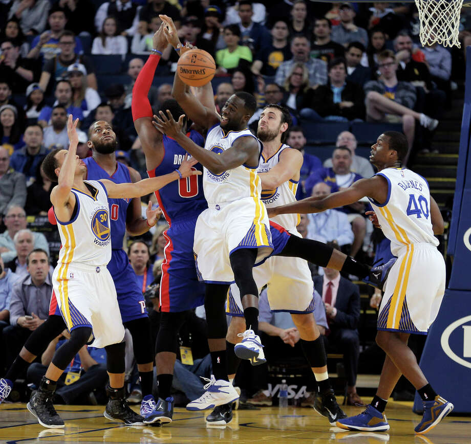 Draymond Green fights for a rebound against the Pistons this month at Oracle Arena. Green has had success recently grabbing defensive rebounds and racing toward the opposing basket. Photo: Carlos Avila Gonzalez / The Chronicle / ONLINE_YES