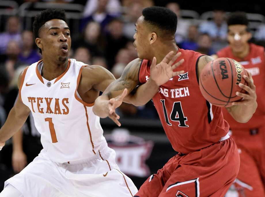 Isaiah Taylor of the Texas Longhorns defends against Robert Turner of the Texas Tech Red Raiders as he looks to pass the ball during the first round of the Big 12 basketball tournament at Sprint Center on March 11, 2015 in Kansas City, Missouri. Photo: Ed Zurga /Getty Images / 2015 Getty Images