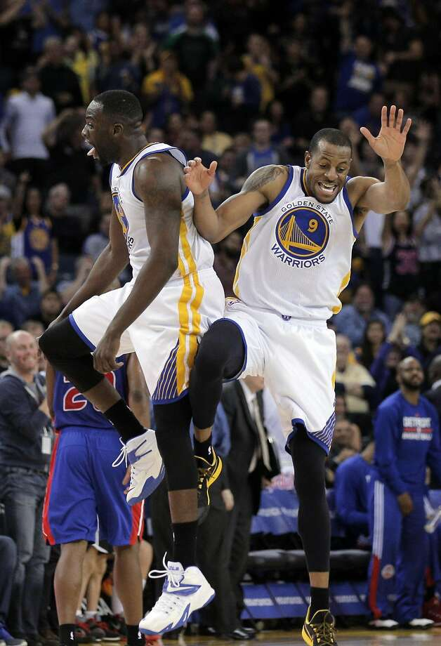 Andre Iguodala (9) and Draymond Green (23) celebrate Iguodala's fourth quarter dunk. The Golden State Warriors played the Detroit Pistons at Oracle Arena in Oakland, Calif., on Wednesday, March 11, 2015. Photo: Carlos Avila Gonzalez, The Chronicle