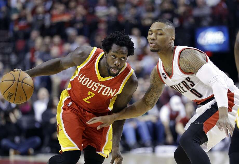 Houston Rockets guard Patrick Beverley, left, drives on Portland Trail Blazers guard Damian Lillard during the first half of an NBA basketball game in Portland, Ore., Wednesday, March 11, 2015. (AP Photo/Don Ryan) Photo: Don Ryan, Associated Press