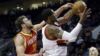 Portland Trail Blazers forward LaMarcus Aldridge, right, pulls in a rebound against Houston Rockets forward Donatas Motiejunas during the first half of an NBA basketball game in Portland, Ore., Wednesday, March 11, 2015. (AP Photo/Don Ryan)