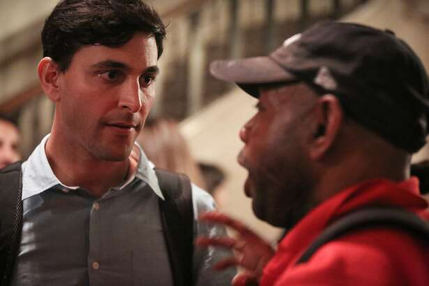 Darcel Jackson, a San Franciscan who has been homeless for two years due to unemployment, confronts Greg Gopman about an unanswered email regarding ideas that could help the homeless at the Nourse Auditorium on Wednesday, March 11, 2015.