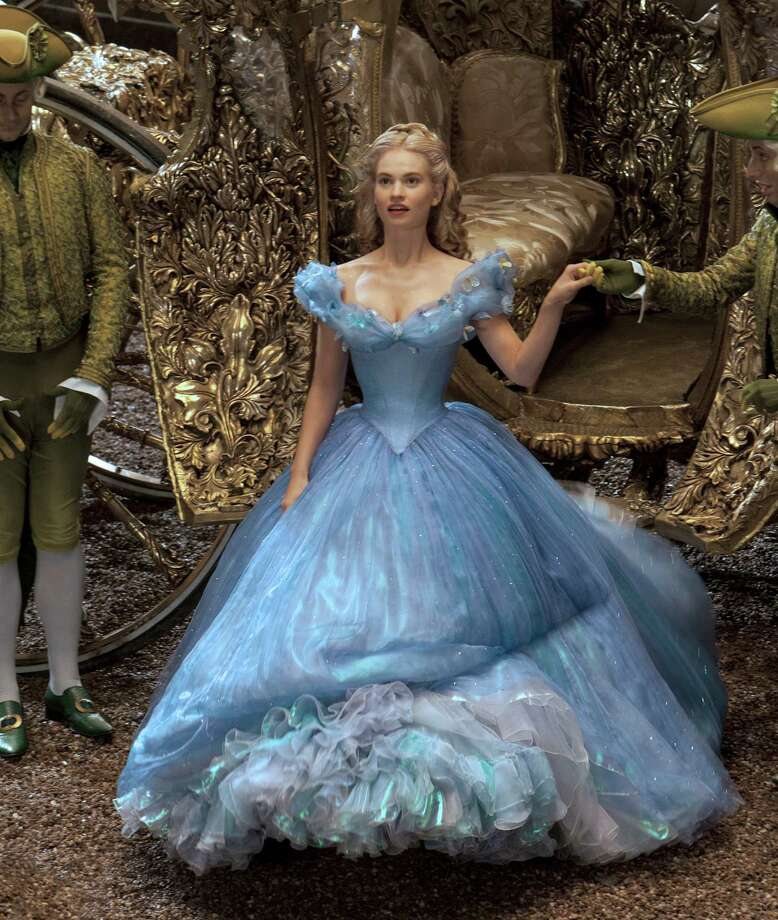 """Lily James is Cinderella in Disney's live-action """"Cinderella,"""" directed by Kenneth Branagh. Illustrates FILM-CINDERELLA-ADV13 (category e), by Ann Hornaday © 2015, The Washington Post. Moved Wednesday, March 11, 2015. (MUST CREDIT: Jonathan Olley/Disney Enterprises.) Photo: HANDOUT, STR / Washington Post / THE WASHINGTON POST"""