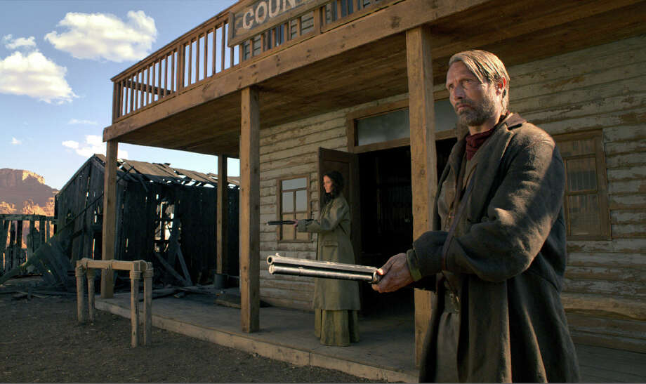 """Mads Mikkelsen stars as a Danish-born American immigrant avenging his family's death in the Western """"The Salvation,"""" which also features Eva Green (left). Illustrates FILM-SALVATION-ADV13 (category e), by Stephanie Merry © 2015, The Washington Post. Moved Monday, March 9, 2015. (MUST CREDIT:  Jens Schlosser/IFC Films.) Photo: HANDOUT, STR / Washington Post / THE WASHINGTON POST"""