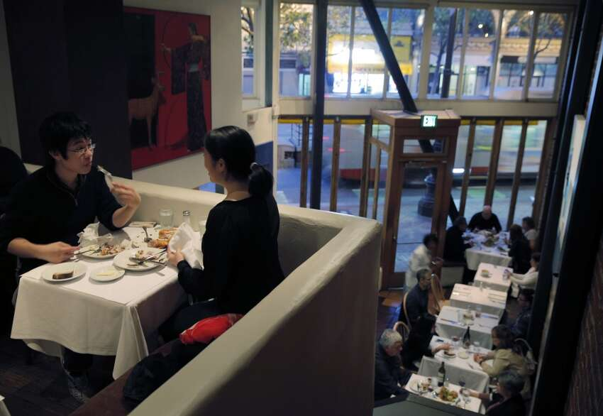 Guests enjoy dinner in the upstairs dining room at Zuni Cafe
