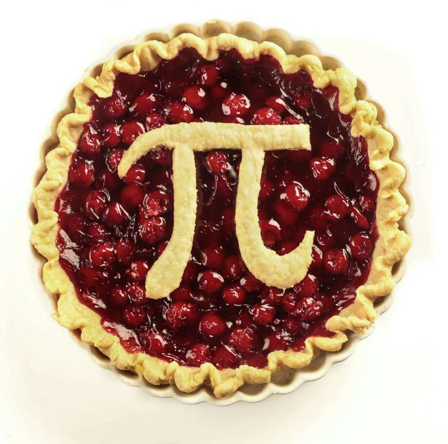Pi is the ratio of a circle'€™s circumference to its diameter. March 14, 2015 (3-14-15) is an important day for pi lovers since the date corresponds to its first five digits (3.1415). The pie decorated with the pi symbol was baked by Elizabeth Pudwill. Photo: Billy Smith II, Staff / © 2015 Houston Chronicle