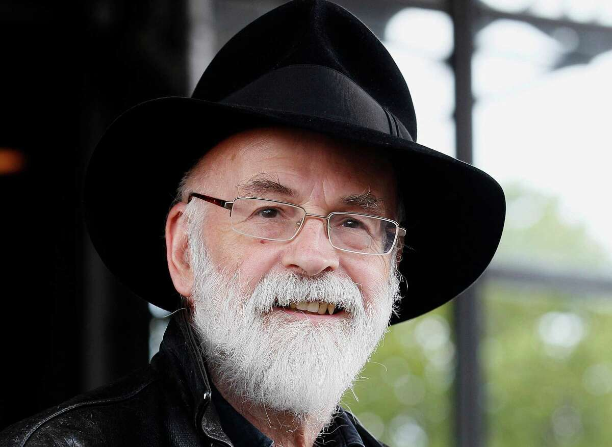 FILE - This is a Tuesday, Oct. 5, 2010 file photo of British author Terry Pratchett seen at the Conservative party conference in Birmingham, England. Fantasy writer Pratchett, creator of the