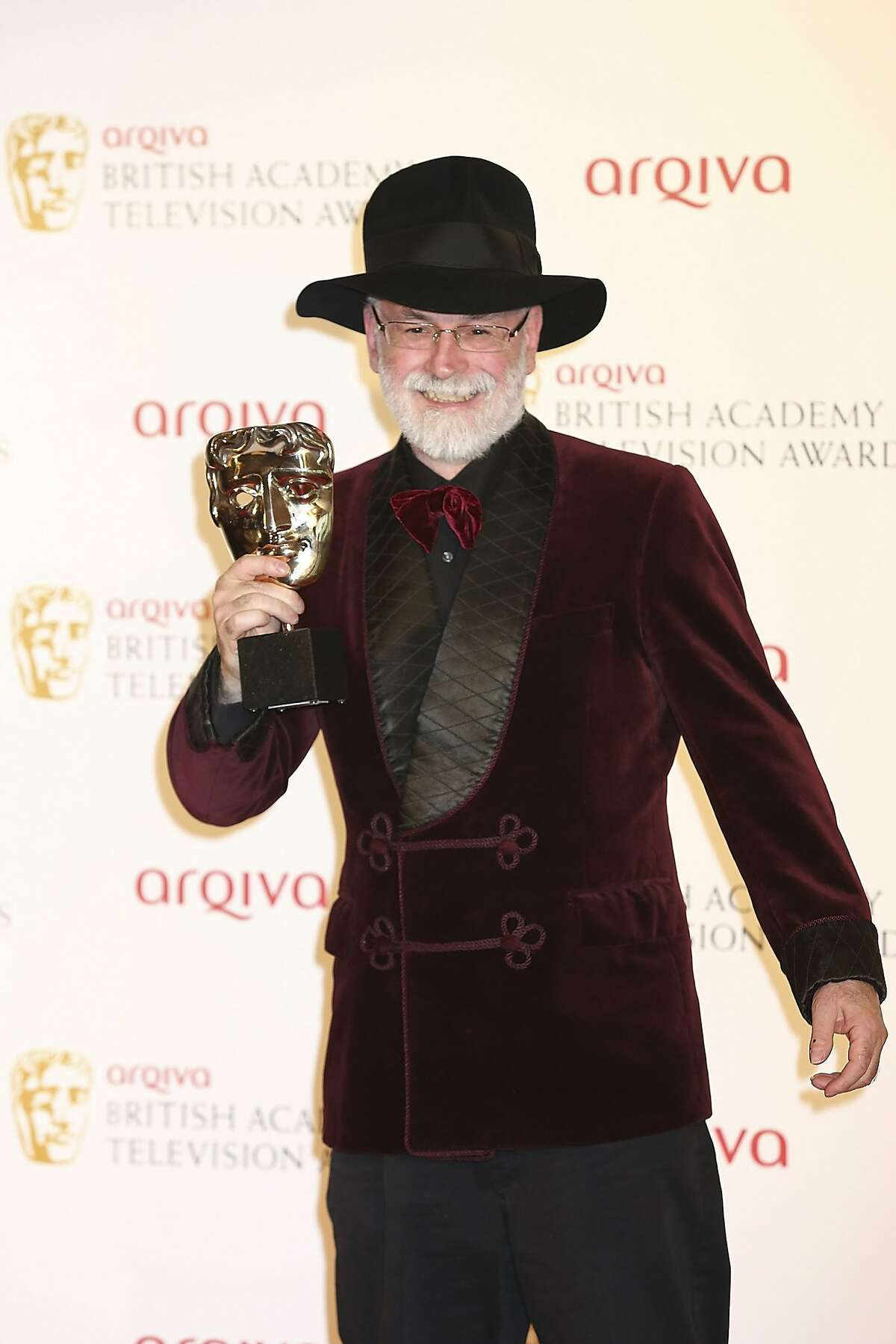 FILE PHOTO: Author Terry Pratchett has died from Alzheimers disease aged 66 LONDON, ENGLAND - MAY 27: Winner of Best Single Documentary Terry Pratchett poses in front of the winners boards at the Arqiva British Academy Television Awards 2012 held at Royal Festival Hall on May 27, 2012 in London, England. (Photo by Tim Whitby/Getty Images)