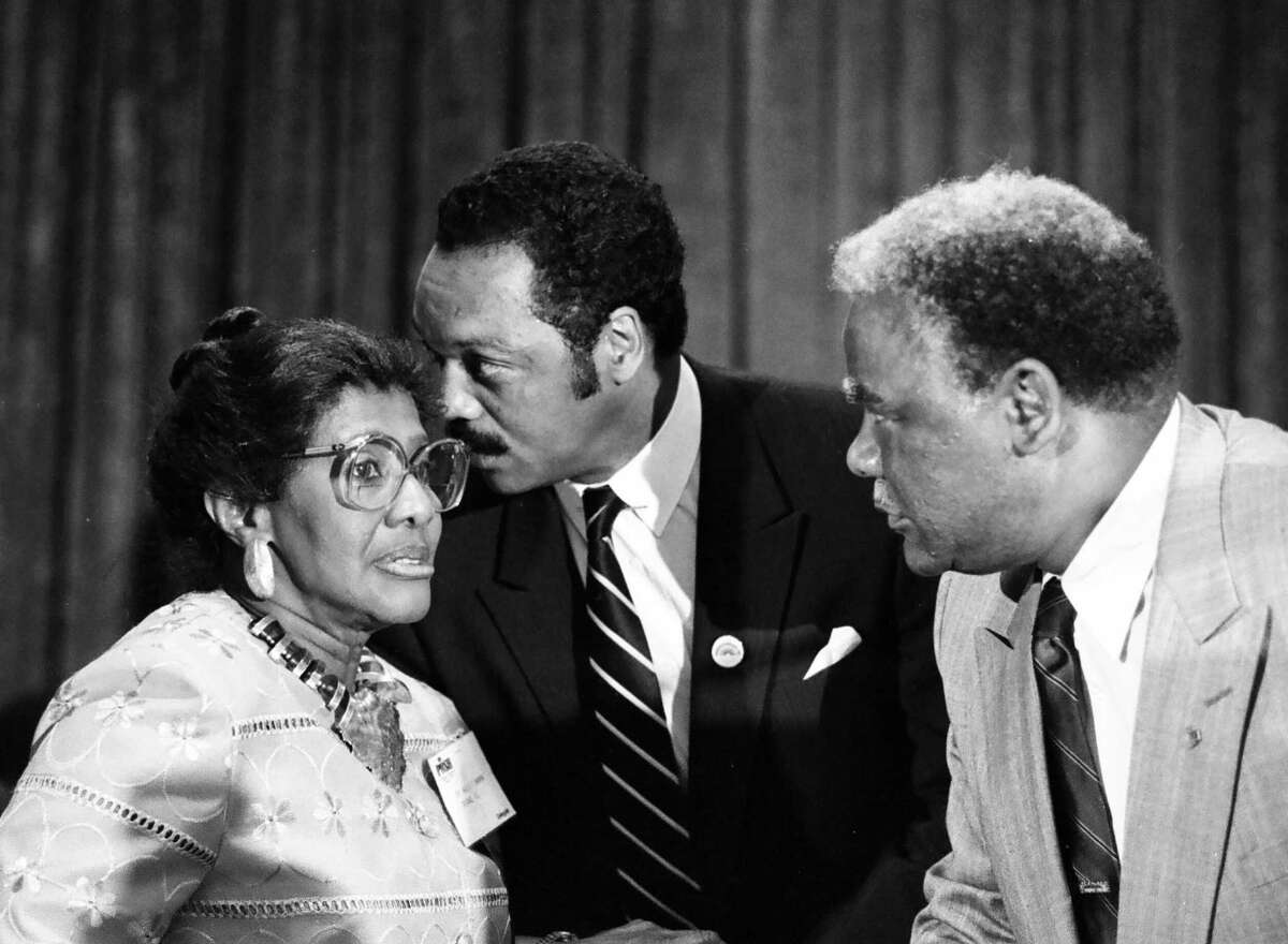 In this Aug. 3, 1986 photo, the Rev. Willie T. Barrow, left, confers with Jesse Jackson Jr., center, and Chicago Mayor Harold Washington during the Operation Push convention in Chicago. Barrow, a longtime civil right activist, died Thursday, March 12, 2015, at a hospital where she was being treated for a blood clot in her lung. She was 90. CHICAGO TRIBUNE OUT, MANDATORY CREDIT, MAGS OUT,